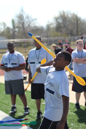 Daniel Turner, 13, an athlete from Muskogee High School, throws a foam dart in the turbo javelin event. High winds Saturday made the turbo javelin even more challenging for the athletes.