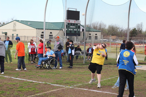 A contestant at the Special Olymics throws a softball on Saturday. The event took place at Indian Bowl in Muskogee, and hosted 370 athletes.