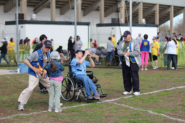 Brian Moore participates in the softball throw. Although wheelchair bound, Moore placed first in the event.