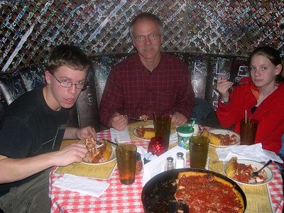 Enjoying Chicago style deep dish pizza at Gino's East.