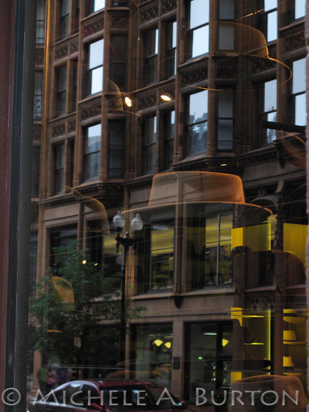 Reflection of Fisher Building<br /> with Optimo Hat store display