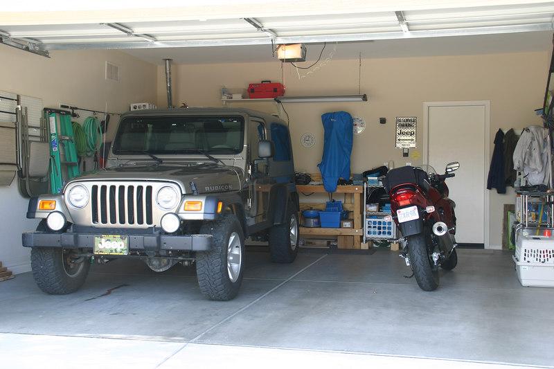 Bonnie's jeep and bike in her garage.