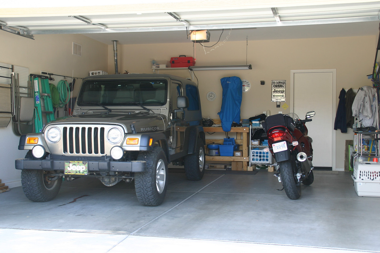 Bonnie's jeep and bike in her garage.