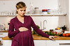 TA3.11 / How do pregnant woman's emotional states and stress affect prenatal development? <br /> <br /> Choice  10 of 13<br /> <br /> Pregnant woman standing in kitchen --- Image by © suedhang/cultura/Corbis