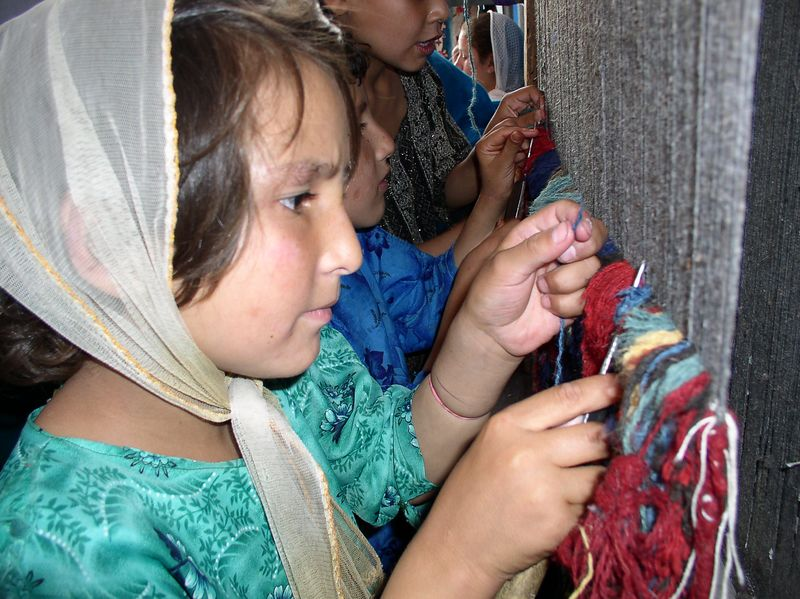 8 year olds weaving a rug at Allahuddin Orphanage (craft room ).