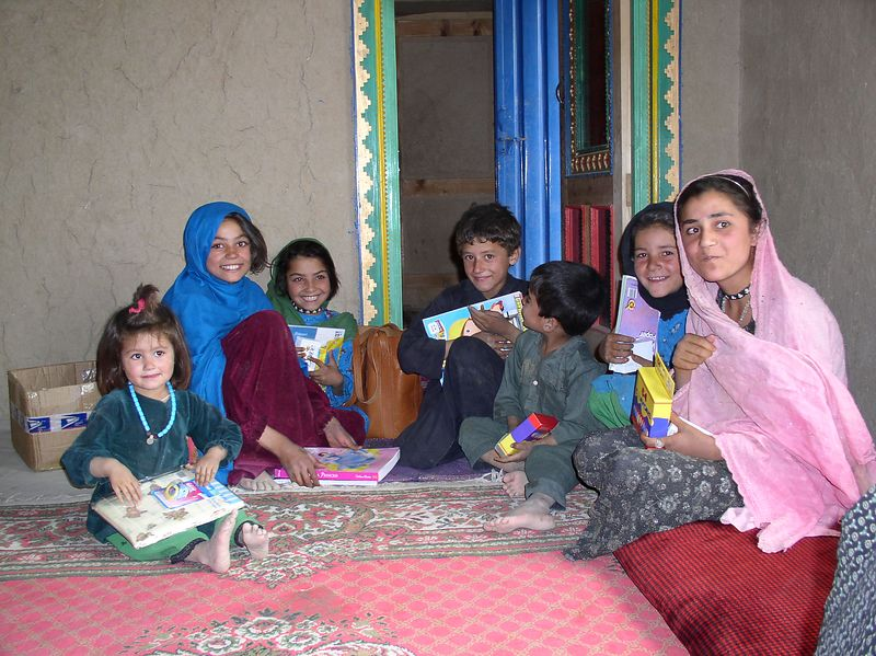 The children of a family in Kalia Kashif enjoyed their treasures. See the next photo.