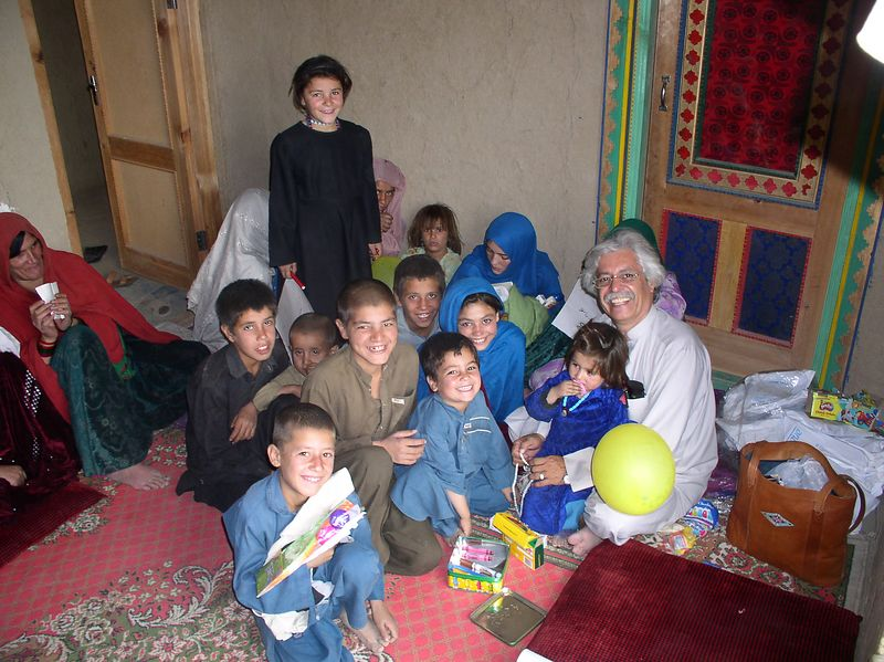 "Rahim Pushtoonyar and his ""family"".....""Pushtoonies""! It was Rahim's birthday, and the ""first"" he ever celebrated. Afghanis do not celebrate birthdays.See next photo."