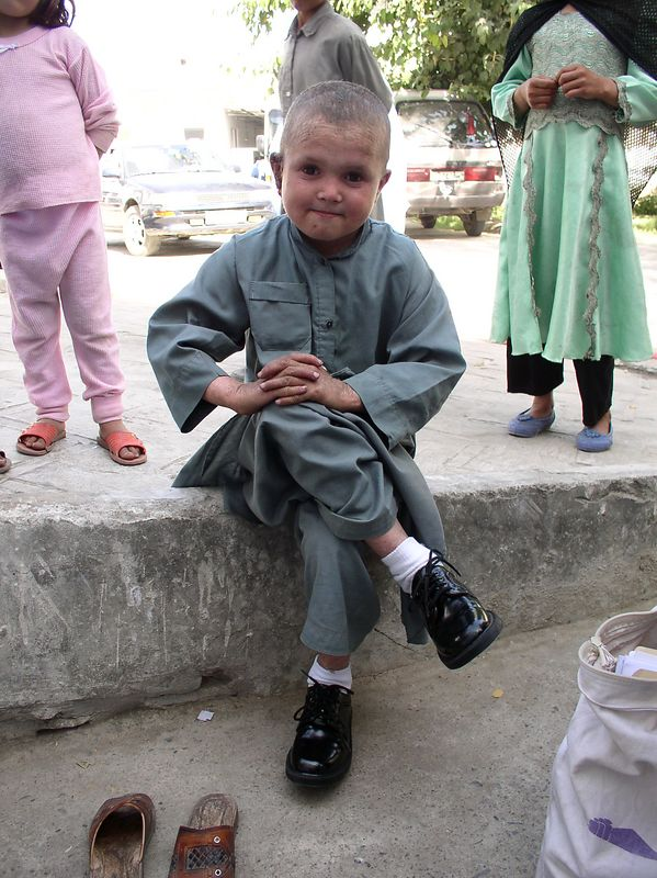 Raheem in new shoes - donated by Jefferson Calico's church group in Kentucky. See next one, too.