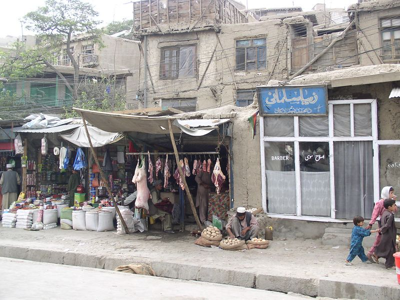 """This is Kabul shopping...what you don't see is a selection of dead birds (ordinary, feathers on, small gray ones that don't look """"tasty """"!)"""