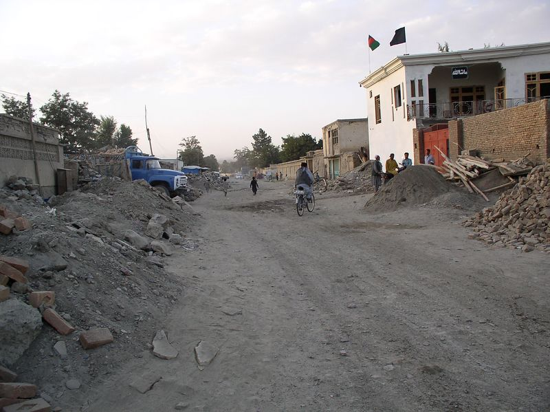 Looking down the neighborhood street. You can see a new building going up midst the rubble. Typical scene.