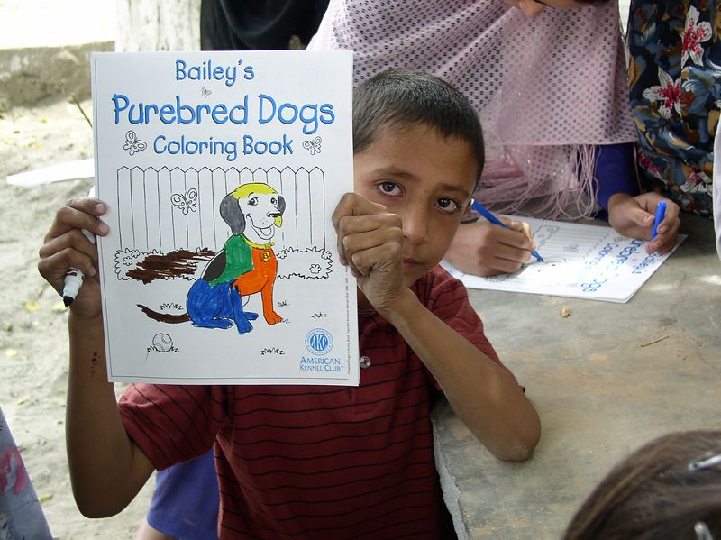 Zane, Pepi and the American Kennel Club donated hundreds of coloring books and crayons. The kids love them and are practicing English. Thank you. see next one, too.