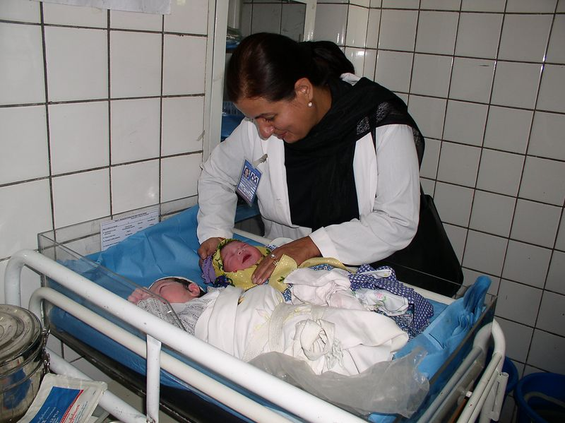 Dr. Soraya Kayoumy from the CDC and two of the beautiful Afghani babies born today (September 7, 2003)