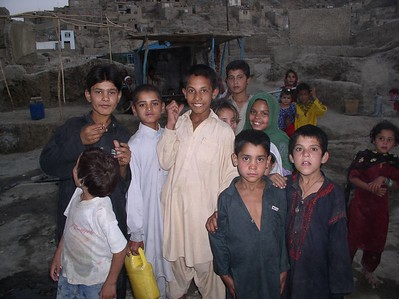 Kabul Kids - they live in an area of Kabul that resembles biblical times - homes built into the mountainside, transportation by foot/donkey, no electricity, water by well. Aren't they beautiful ? This was their evening gathering.