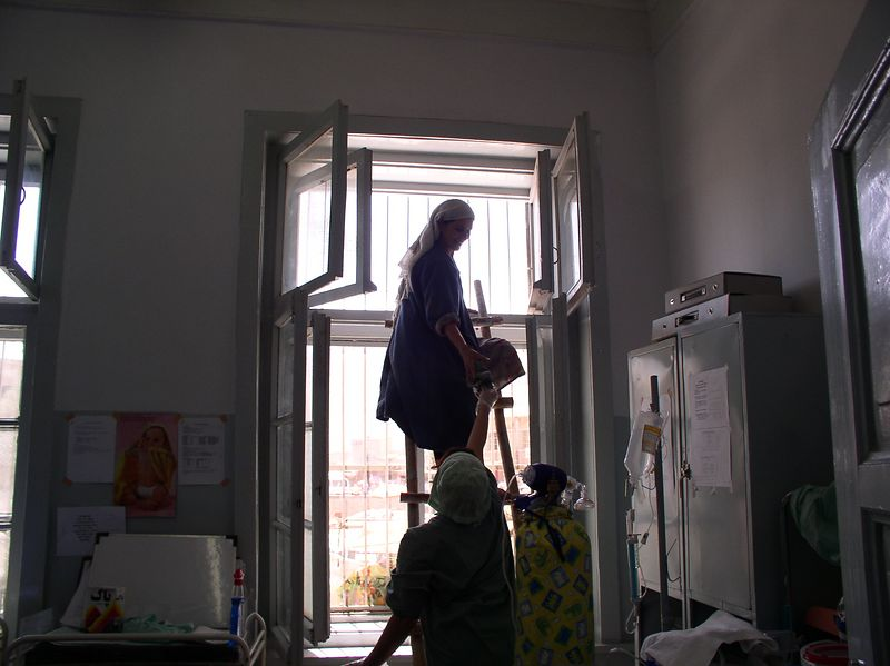 Later that day, here is Fawzia helping the dear cleaning lady clean the last remaining cob web out of the top nursery windows. Curtains are coming next week.