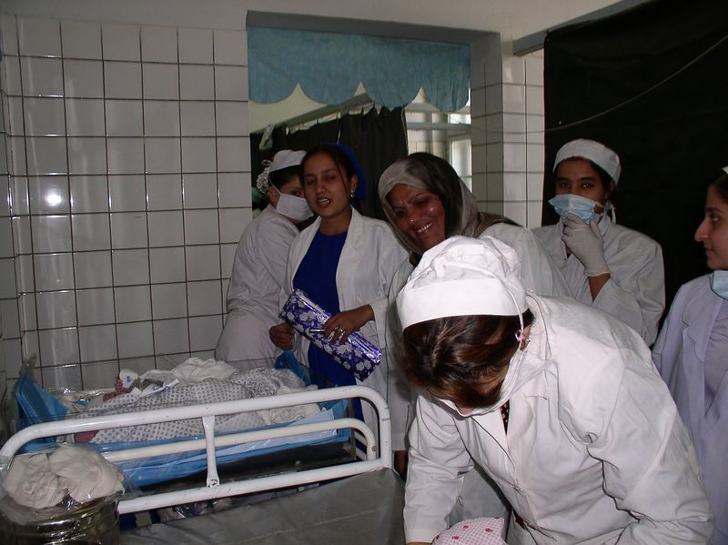 The student midwives learning to clean and wrap babies. The next experience was infection control by high cleaning the baby table in the delivery room. The ones with masks are student midwives-excellent young ladies learning the basic science of nursing-Cleanliness.Florence would be proud.