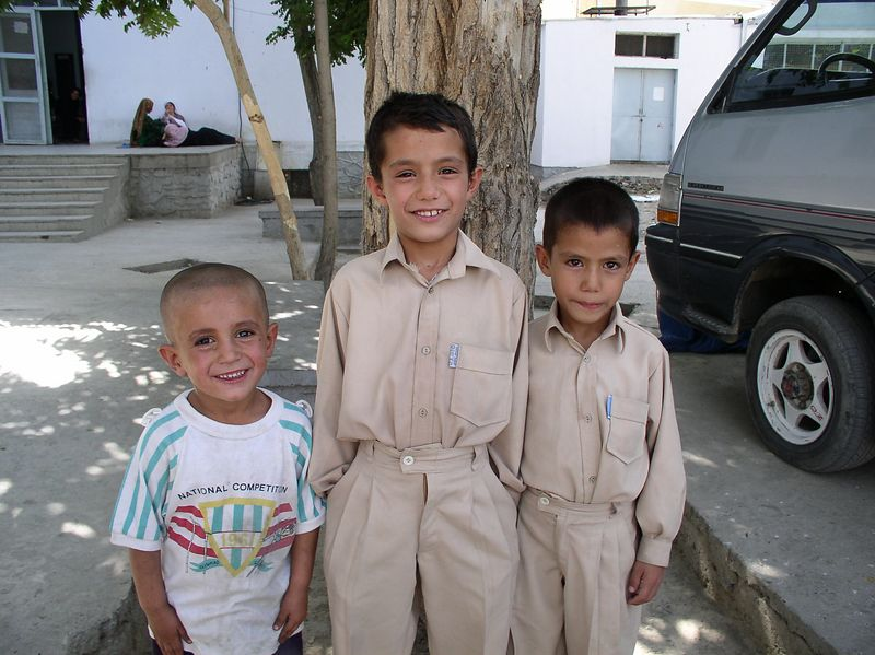 The shirt boys. The 2 matching are sibs and their mother dressed them up, brought them to work and asked me to take their picture. The extra fellow is from the courtyard. I thought his shirt is a good example of what I talked about in my last letter-do you think he was around in 1961 ?