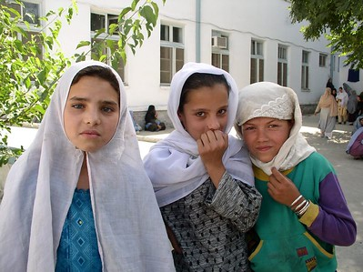 "Iyarina and other girls outside Rabia Balkhi. Afghani's are ""serious"" for their pictures. I invited the boys in the following picture to ""smile"". Check it out."