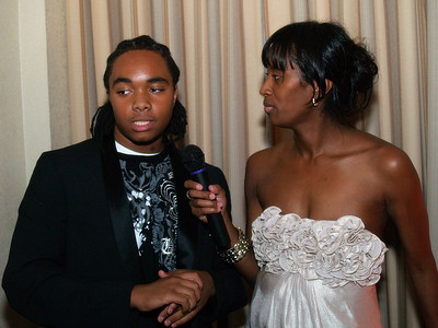 "(L) to (R) Award-Winning Performer and DJ, Tony ""T-Rep"" Betton, Jr., a two-time Winner of The 2010 YEGA Award and Monique Evans, Founder & President of Children's Pride, Inc."