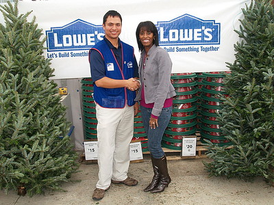(L) to (R) Mark Smith, Lowe's Store Manager and Monique Evans, Children's Pride Founder & President.