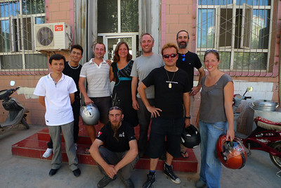 Group photo outside 'Newland Travel', the agency who are guiding us through China.