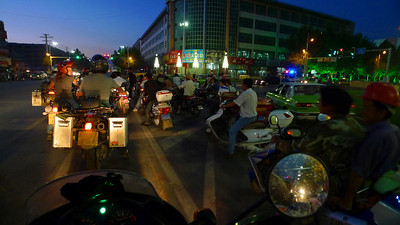 Riding back to the hotel after a day doing work on the bikes. At each junction we are joined by more and more bikes.
