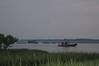 U.S.Coast Guard patroling before the ponies swim accross the channel from Assateague.