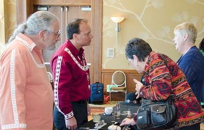 "Artist George ""Shukata"" Willis and Assistant Chief Gary Batton talk with visitors to the Choctaw cultural meeting in La Jolla, Calif., on Feb. 16. Mr. Willis's original pieces often reflect his Choctaw heritage."