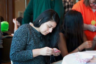 Leilani Hernandez of Phoenix, Ariz. tries her hand at creating a pair of Choctaw earrings.