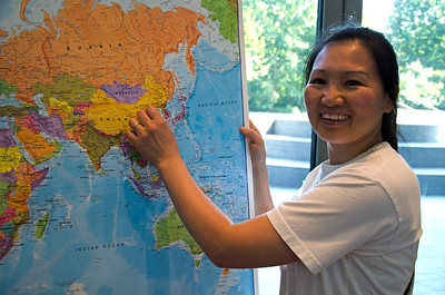 Hongmei of China marks her home country on the map.
