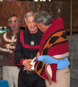 Chief Pyle presents Kevin Gover with a Pendleton blanket