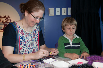 Rebecca and Max Gelfond work together on their beading projects.
