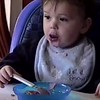 Boys eat breakfast Age 1