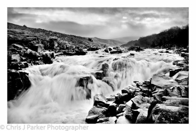 Black & White image of water cascading over rocks at High Force