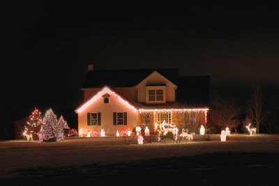 Dan Hrinda of 45349 East Hamilton in Oberlin has been collecting Christmas statues for years as a hobby, adding to his collection every year. This year it took three days to put up his lighting display. he would have put up more if not for all the rain. photo by Ray Riedel
