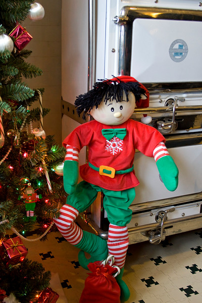 An elf by the kitchen stove