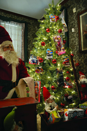 """This """"Santaland Express,"""" created by Carriage House Event Center, greets visitors to the mansion.  Cathy Griffith photo"""