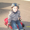 The boys have these little red go-kart's that they zoom around the neighborhood on...They have such fun