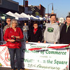 Lisa Kriehn of Love INC (in red) cuts the ribbon to open Christmas on the Square. She is surrounded by Chamber of Commerce officials.
