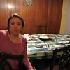 Lisa setting the table.