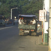 Typical shared local transport, downtown Rangoon, Burma.