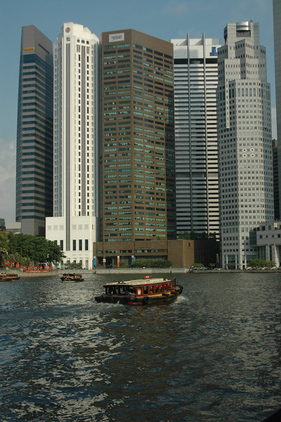 Boat on canal, downtown Singapore.