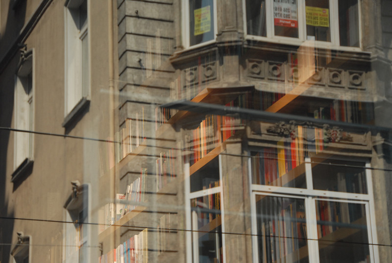 Reflection in bookstore glass, Istiklal Caddesi (Independence Avenue), the main predominantly pedestrian shopping street, Istanbul, Turkey.