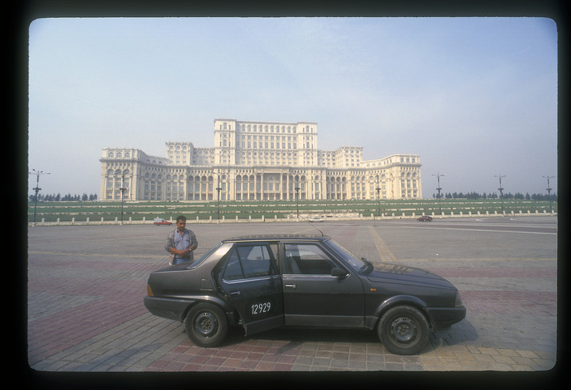 Palace built by Nicolae Ceausescu, begun in 1983, now serving as the Palace of the Parliament, Bucharest, Romania. With taxi.