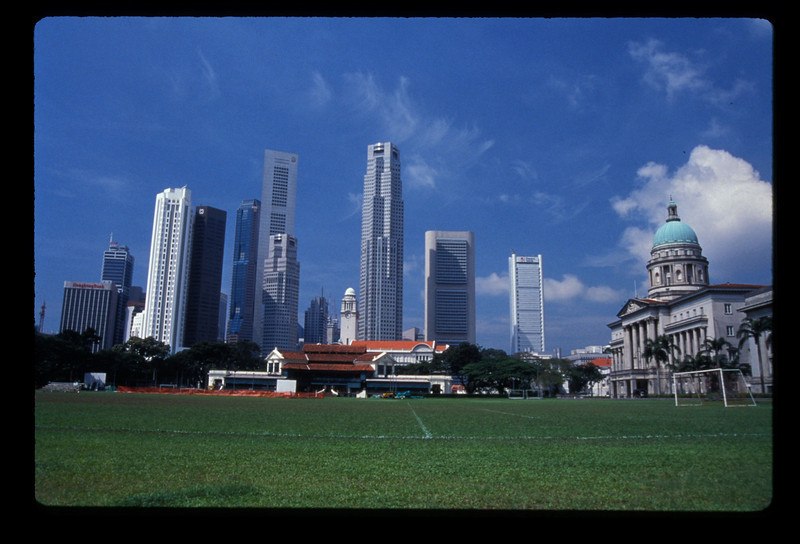 Football pitch, City Hall & downtown Singapore.