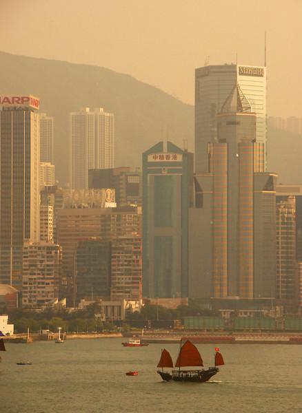 Junk on Victoria harbor and Hong Kong, China.