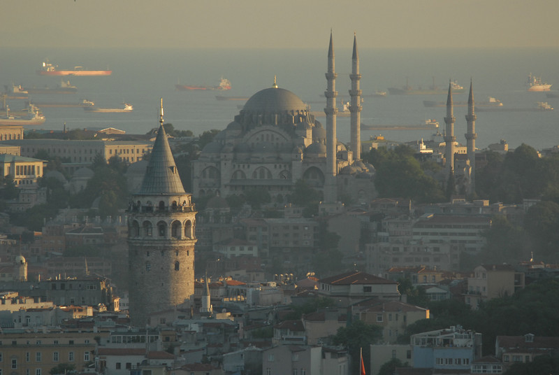 Galata Tower foreground, Suleymaniya Mosque and ships in the Sea of Marmara, Istanbul.