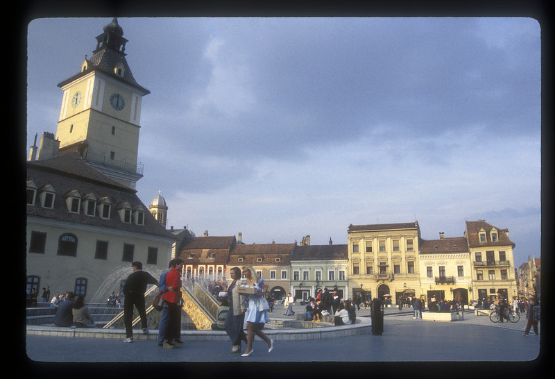 People on the central square in Brasov, Transylvania, Romania.