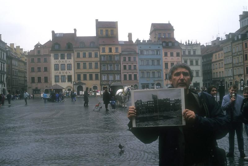 The rebuilt Jewish ghetto and photo of prior war damage, Warsaw, Poland.
