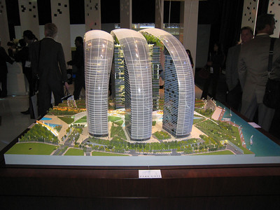 "This is part of the development to replace Satwa, the building is called Park Gate.  Quote from the newspaper: ""Park Gate is made up of three pairs of 30 to 40-storey buildings connected by a shallow archway at the top. Suspended from the middle of the tunnel-like structures are ""hanging gardens"".  The gardens will help shade the development, and together with other gardens and plants, cool the neighbourhood by as much as 10 degrees centigrade, according to the company.  Initial construction has already begun on this project in the Satwa and Al Wasl neighbourhoods."