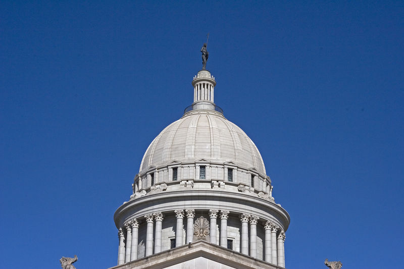 """The State of Oklahoma capitol dome with the """"Guardian"""" statue on top."""